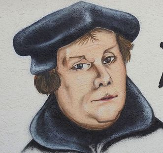 Martin Luther on the wall of a building. Image: Pixabay, in the public domain